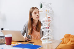 Bright thoughtful woman studying the genome Stock Photo