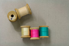 Bright Thread. Vintage wooden spools with bright colored thread Stock Images