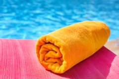 Bright towel on a lounger, vacation Royalty Free Stock Image