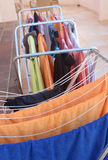 Bright towels drying. Towels and swimming clothes hanging on on drying racks on a terrace Stock Photo