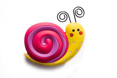 Bright toy snail. Toy bright snail on white background Royalty Free Stock Photography