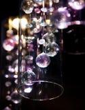 Bright transparent glass light balls. Bright transparent glass balls as dark background Royalty Free Stock Image