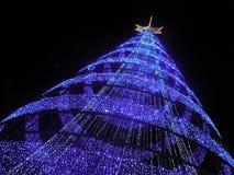 Bright tree made of christmas lights royalty free stock photo