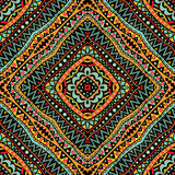 Bright Tribal Seamless Pattern. Seamless geometric pattern in bright colors. Abstract symmetric pattern. Tribal background ornament. Colorful texture Stock Photos