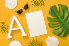 Bright tropical flat lay with blank paper sheet stock photo