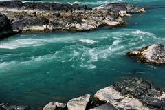Bright turquoise mountain river Katun,  clean ecological water  running royalty free stock photo