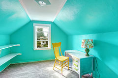 Bright turquoise room with desk and chair. Small bright turquoise room with vaulted ceiling and shelves attached to the wall. Room has desk and chair Stock Images