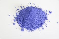Bright ultramarine pigment isolated over white. Extreme close up of bright ultramarine pigment isolated over white background Royalty Free Stock Photo