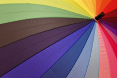 Bright umbrella with rainbow colors closeup Royalty Free Stock Images