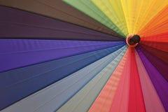 Bright umbrella with rainbow colors closeup Stock Photos