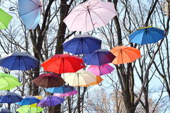 Bright umbrellas. Bright, Vivid Colors. Freedom concept. Multicolored umbrellas in the sky. Rainbow Colors Stock Photos
