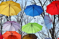 Bright umbrellas.  Freedom concept. Multicolored umbrellas in the sky. Rainbow Colors Stock Images