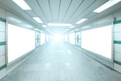 Bright underpass with blank billboard advertising wall Royalty Free Stock Photo