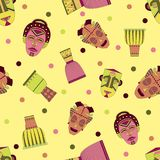 Bright vector seamless pattern with african masks. And drums royalty free illustration