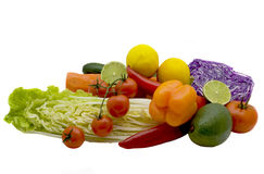 Bright vegetables. Bright tomatoes, carrots, cabbage, cucumbers and pepper on a white background Royalty Free Stock Photos