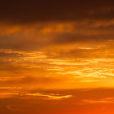 Bright vibrant orange and yellow colors sunset sky Royalty Free Stock Photos