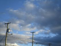 Bright view of clouds, blue sky and power lines on a fine winter day. Canada 2018 Stock Photography