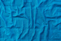 Bright vivid blue wrinkled linen fabric Royalty Free Stock Photos