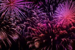 Bright vivid purple fireworks with sparks. Explosive pyrotechnic devices for aesthetic and entertainment purposes, art. Close-up of vivid purple fireworks with stock photography