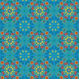 Bright vivid red and blue floral symmetrical repeating pattern in Islamic style royalty free illustration