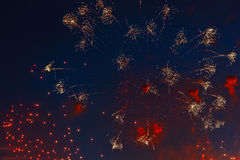 Bright volleys of fireworks in evening sky Stock Photos