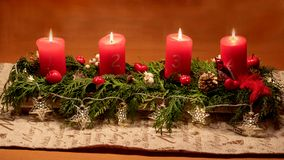 In this bright waiting for Christmas time, we light up four candles. The traditional Advent wreath can be replaced by self-made c royalty free stock photo