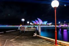 Bright walkway with opera house in night royalty free stock photo
