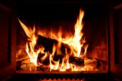 Bright and warm melted fireplace with flames and sparks Royalty Free Stock Photography