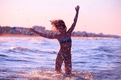 Bright water drops on background of silhouette of girl royalty free stock photos
