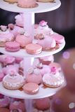 Bright wedding cake, with Mr Ms cake. Cupcakes stock photo