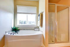 Bright white bathroom with window Royalty Free Stock Photos