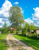 Bright white clouds on the blu sky bavkground in the subutban village. Sunny bright day with white clouds stock photo