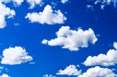 Bright White Cumulus Clouds in the Clear Blue Sky on a Summer Day.  royalty free stock images