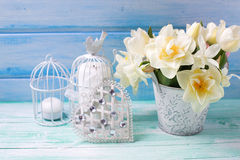 Bright white daffodils and tulips  flowers in bucket, decorative Royalty Free Stock Images