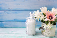 Bright white daffodils and tulips  flowers, candle on turquoise Stock Photography