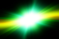 Bright white flash on a green and black background. Royalty Free Stock Photography