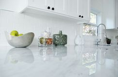 Kitchen Counter. White kitchen with carrara marble countertops and chrome faucet Royalty Free Stock Images