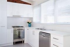 Bright white modern apartment kitchen Stock Photos