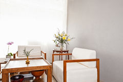 Bright white seater in lounge area Stock Images