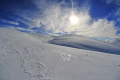 Bright white slopes on a sunny winter day Royalty Free Stock Images