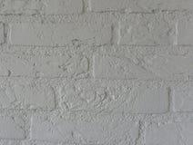 Bright white stone brick wall background with modern bricks pattern. A bright white stone brick wall background with modern bricks pattern royalty free stock photos