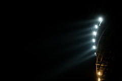 Bright white and yellow Stadium lights with fog Royalty Free Stock Photos