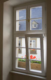 Bright window. Through this bright window you can see the colorful world outside. open it to let the fresh air in Stock Photo