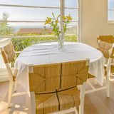 Bright window with flowers and wicker chairs. In a luxury kitchen with a beautiful view of coastal southern California stock images