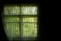 A bright window in the room on a black background Royalty Free Stock Photography