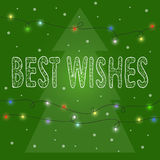 Bright winter holidays card background. Bright green winter holidays card background with  hand-drawing best wishes, lights and spruce Royalty Free Stock Images