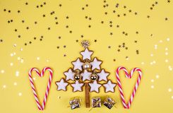 Christmas composition with gifts and christmas tree. Bright winter holidays christmas composition with gifts and christmas tree made of cinnamon cookies Royalty Free Stock Photos