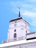 Bright winter noon. White tower clock & weather vane in blue winter sky, in Minsk, Belarus Royalty Free Stock Photography