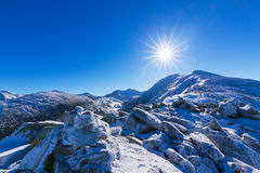 Bright winter scenery in the mountains, with frost and rocks covered with fresh snow. On a cold freezing day Stock Photos