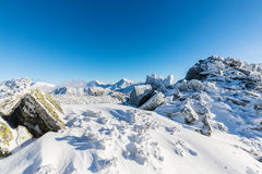 Bright winter scenery in the mountains, with frost and rocks covered with fresh snow. On a cold freezing day Stock Photography